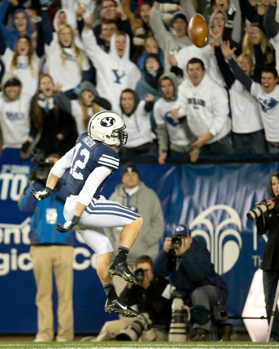 Sep 27, 2013; Provo, UT, USA; Brigham Young Cougars wide receiver JD Falslev (12) reacts to returning a punt for a touchdown during the second half against the Middle Tennessee Blue Raiders at Lavell Edwards Stadium. Brigham Young won 37-10. Mandatory Credit: Russ Isabella-USA TODAY Sports