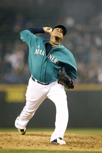 Sep 27, 2013; Seattle, WA, USA; Seattle Mariners starting pitcher Felix Hernandez (34) throws against the Oakland Athletics during the fourth inning at Safeco Field. Mandatory Credit: Joe Nicholson-USA TODAY Sports
