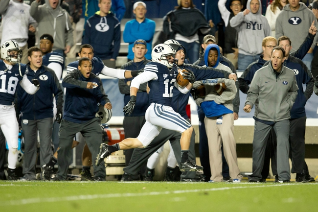 Sep 27, 2013; Provo, UT, USA; Brigham Young Cougars wide receiver JD Falslev (12) runs along the sideline as he returns a punt for a touchdown during the second half against the Middle Tennessee Blue Raiders at Lavell Edwards Stadium. Brigham Young won 37-10. Mandatory Credit: Russ Isabella-USA TODAY Sports