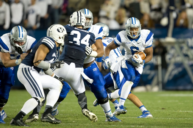 Sep 27, 2013; Provo, UT, USA; Middle Tennessee Blue Raiders running back Jordan Parker (6) runs with the ball during the second half against the Brigham Young Cougars at Lavell Edwards Stadium. Brigham Young won 37-10. Mandatory Credit: Russ Isabella-USA TODAY Sports