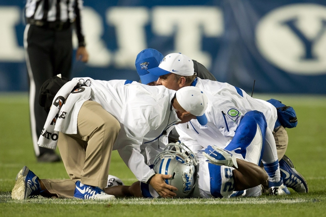 Sep 27, 2013; Provo, UT, USA; Medical staff attend to Middle Tennessee Blue Raiders running back William Pratcher (29) after he sustained an injury during the second half against the Brigham Young Cougars at Lavell Edwards Stadium. Brigham Young won 37-10. Mandatory Credit: Russ Isabella-USA TODAY Sports