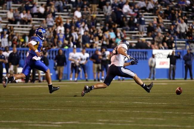 Sep 27, 2013; San Jose, CA, USA; Utah State Aggies linebacker Jake Doughty (51) recovers the high snap ahead of San Jose State Spartans quarterback David Fales (10) during the third quarter at Spartan Stadium. The Utah State Aggies defeated the San Jose State Spartans 40-12. Mandatory Credit: Kelley L Cox-USA TODAY Sports