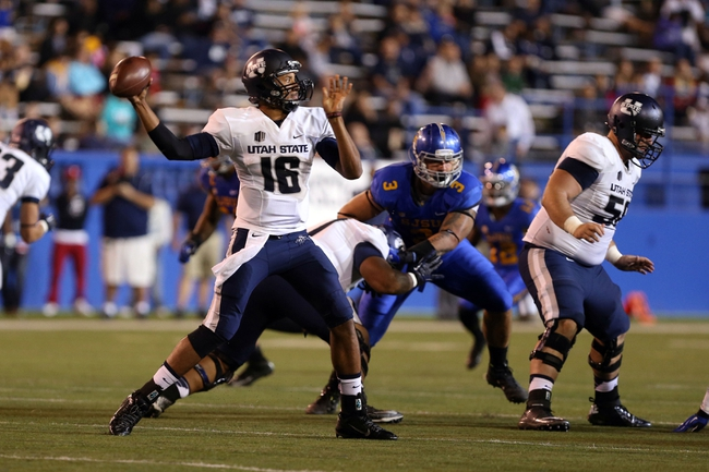 Sep 27, 2013; San Jose, CA, USA; Utah State Aggies quarterback Chuckie Keeton (16) passes the ball against the San Jose State Spartans during the third quarter at Spartan Stadium. The Utah State Aggies defeated the San Jose State Spartans 40-12. Mandatory Credit: Kelley L Cox-USA TODAY Sports