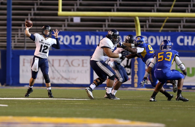 Sep 27, 2013; San Jose, CA, USA; Utah State Aggies quarterback Craig Harrison (12) passes the ball against the San Jose State Spartans during the fourth quarter at Spartan Stadium. The Utah State Aggies defeated the San Jose State Spartans 40-12. Mandatory Credit: Kelley L Cox-USA TODAY Sports