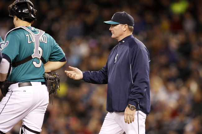 Sep 27, 2013; Seattle, WA, USA; Seattle Mariners manager Eric Wedge (22) relieves a pitcher during the seventh inning against the Oakland Athletics at Safeco Field. Mandatory Credit: Joe Nicholson-USA TODAY Sports