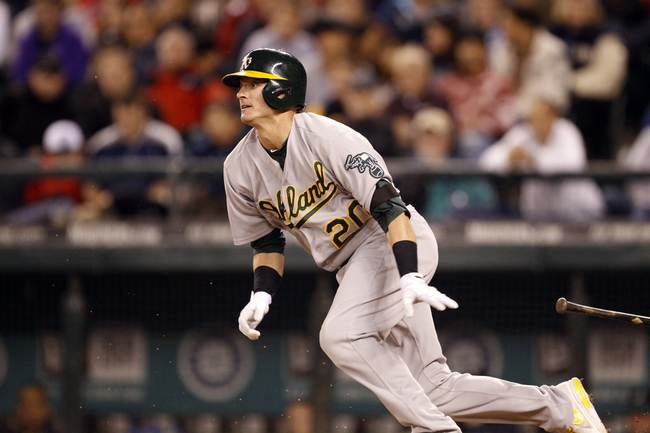 Sep 27, 2013; Seattle, WA, USA; Oakland Athletics third baseman Josh Donaldson (20) hits an RBI-fielder's choice against the Seattle Mariners during the seventh inning at Safeco Field. Mandatory Credit: Joe Nicholson-USA TODAY Sports