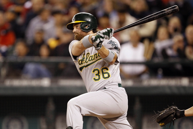 Sep 27, 2013; Seattle, WA, USA; Oakland Athletics catcher Derek Norris (36) hits an RBI-double against the Seattle Mariners during the eighth inning at Safeco Field. Mandatory Credit: Joe Nicholson-USA TODAY Sports