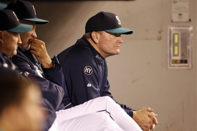 Sep 27, 2013; Seattle, WA, USA; Seattle Mariners manager Eric Wedge (22) sits in the dugout during the ninth inning against the Oakland Athletics at Safeco Field. Mandatory Credit: Joe Nicholson-USA TODAY Sports