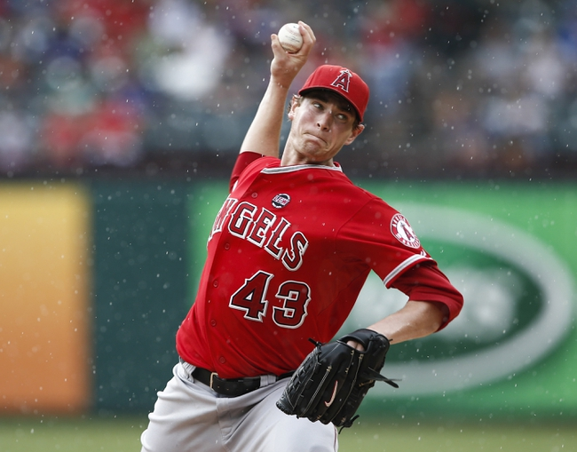 Sep 28, 2013; Arlington, TX, USA; Los Angeles Angels starting pitcher Garrett Richards (43) delivers a pitch to the Texas Rangers during the first inning of a baseball game at Rangers Ballpark in Arlington. Mandatory Credit: Jim Cowsert-USA TODAY Sports