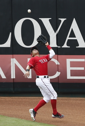 Sep 28, 2013; Arlington, TX, USA; Texas Rangers center fielder Leonys Martin (2) makes a catch on a fly out hit by Los Angeles Angels catcher Chris Iannetta (not pictured) during the second inning of a baseball game at Rangers Ballpark in Arlington. Mandatory Credit: Jim Cowsert-USA TODAY Sports