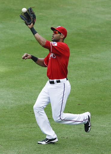 Sep 28, 2013; Arlington, TX, USA; Texas Rangers right fielder Alex Rios (51) catches the fly out hit by Los Angeles Angels third baseman Andrew Romine (not pictured) during the second inning of a baseball game at Rangers Ballpark in Arlington. Mandatory Credit: Jim Cowsert-USA TODAY Sports