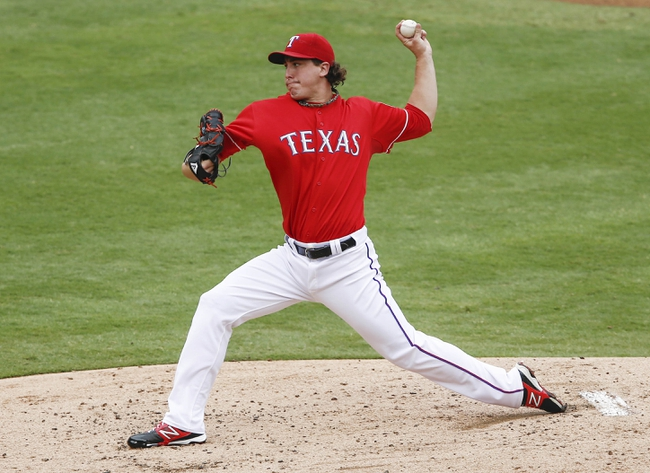Sep 28, 2013; Arlington, TX, USA; Texas Rangers starting pitcher Derek Holland (45) delivers a pitch to the Los Angeles Angels during the second inning of a baseball game at Rangers Ballpark in Arlington. Mandatory Credit: Jim Cowsert-USA TODAY Sports