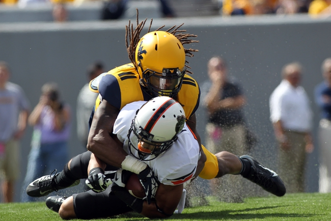 Sep 28, 2013; Morgantown, WV, USA; Oklahoma State Cowboys safety Daytawion Lowe (8) intercepts a pass intended for West Virginia Mountaineers wide receiver Kevin White (11) during the first half at Milan Puskar Stadium. Mandatory Credit: Peter Casey-USA TODAY Sports