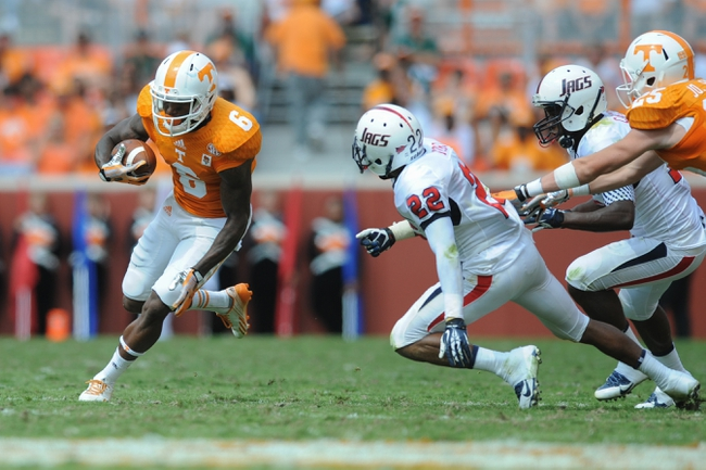 Sep 28, 2013; Knoxville, TN, USA; Tennessee Volunteers wide receiver Vincent Dallas (6) runs the ball against South Alabama Jaguars cornerback Qudarius Ford (22) during the second quarter at Neyland Stadium. Mandatory Credit: Randy Sartin-USA TODAY Sports