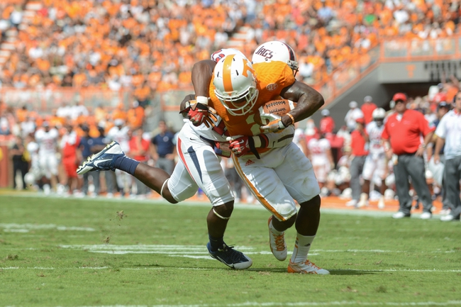 Sep 28, 2013; Knoxville, TN, USA; South Alabama Jaguars safety Devon Earl (13) tackles Tennessee Volunteers wide receiver Alton Howard (2) during the second quarter at Neyland Stadium. Mandatory Credit: Randy Sartin-USA TODAY Sports