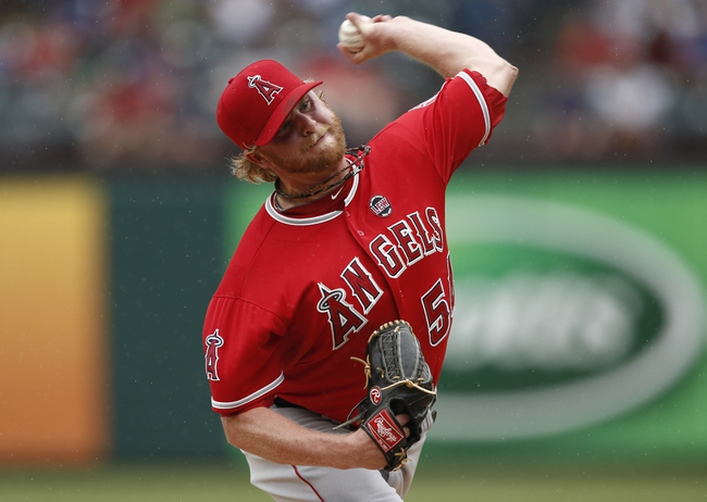 Sep 28, 2013; Arlington, TX, USA; Los Angeles Angels relief pitcher Buddy Boshers (54) delivers to the Texas Rangers during the fifth inning of a baseball game at Rangers Ballpark in Arlington. Mandatory Credit: Jim Cowsert-USA TODAY Sports