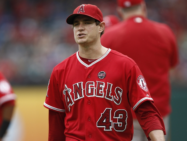 Sep 28, 2013; Arlington, TX, USA; Los Angeles Angels starting pitcher Garrett Richards (43) reacts after departing the game during the fifth inning of a baseball game against the Texas Rangers at Rangers Ballpark in Arlington. Mandatory Credit: Jim Cowsert-USA TODAY Sports