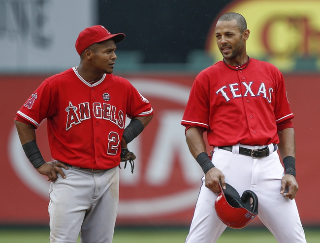 Sep 28, 2013; Arlington, TX, USA; Texas Rangers right fielder Alex Rios (51) and Los Angeles Angels shortstop Erick Aybar (2) talk during a break in action in the fifth inning of a baseball game at Rangers Ballpark in Arlington. Mandatory Credit: Jim Cowsert-USA TODAY Sports