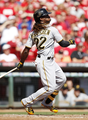 Sep 28, 2013; Cincinnati, OH, USA; Pittsburgh Pirates center fielder Andrew McCutchen (22) watches his home run during the third inning against the Cincinnati Reds at Great American Ball Park. Mandatory Credit: Frank Victores-USA TODAY Sports