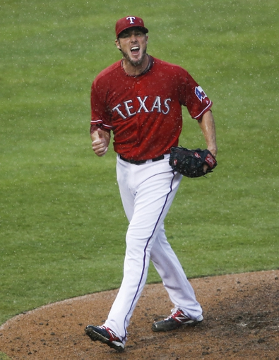 Sep 28, 2013; Arlington, TX, USA; Texas Rangers relief pitcher Joe Nathan (36) reacts after striking out Los Angeles Angels designated hitter Howie Kendrick (not pictured) to end the baseball game at Rangers Ballpark in Arlington. The Rangers won 7-4. Mandatory Credit: Jim Cowsert-USA TODAY Sports