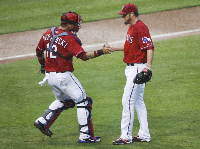 Sep 28, 2013; Arlington, TX, USA; Texas Rangers catcher A.J. Pierzynski (12) congratulates relief pitcher Joe Nathan (36) following their win over the Los Angeles Angels during a baseball game at Rangers Ballpark in Arlington. Mandatory Credit: Jim Cowsert-USA TODAY Sports