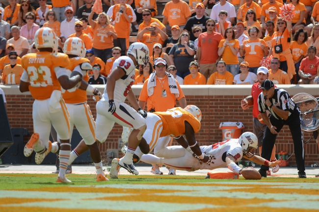 Sep 28, 2013; Knoxville, TN, USA; South Alabama Jaguars quarterback Ross Metheny (2) dives for a touchdown against Tennessee Volunteers defensive lineman Marlon Walls (58) during the second half at Neyland Stadium. Tennessee won 31 to 24. Mandatory Credit: Randy Sartin-USA TODAY Sports