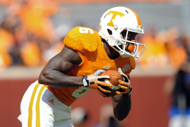 Sep 28, 2013; Knoxville, TN, USA; Tennessee Volunteers wide receiver Vincent Dallas (6) runs the ball against the South Alabama Jaguars during the second half at Neyland Stadium. Tennessee won 31 to 24. Mandatory Credit: Randy Sartin-USA TODAY Sports