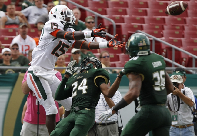Sep 28, 2013; Tampa, FL, USA; South Florida Bulls defensive back Johnny Ward (24) defends Miami Hurricanes wide receiver D'Mauri Jones (15) during the second half at Raymond James Stadium. Miami Hurricanes defeated the South Florida Bulls 49-21. Mandatory Credit: Kim Klement-USA TODAY Sports