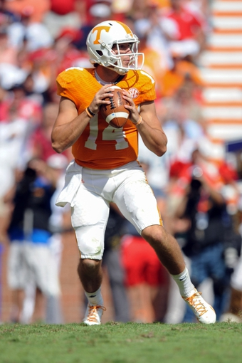 Sep 28, 2013; Knoxville, TN, USA; Tennessee Volunteers quarterback Justin Worley (14) drops back to pass the ball against the South Alabama Jaguars during the second half at Neyland Stadium. Tennessee won 31 to 24. Mandatory Credit: Randy Sartin-USA TODAY Sports
