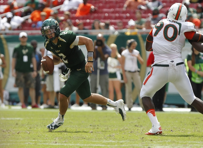 Sep 28, 2013; Tampa, FL, USA; South Florida Bulls quarterback Steven Bench (2) runs out of the pocket during the second half against the Miami Hurricanes at Raymond James Stadium. Miami Hurricanes defeated the South Florida Bulls 49-21. Mandatory Credit: Kim Klement-USA TODAY Sports