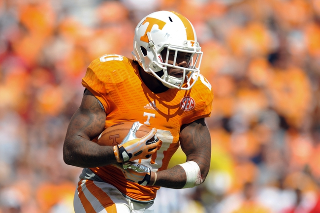 Sep 28, 2013; Knoxville, TN, USA; Tennessee Volunteers running back Rajion Neal (20) runs the ball against the South Alabama Jaguars during the second half at Neyland Stadium. Tennessee won 31 to 24. Mandatory Credit: Randy Sartin-USA TODAY Sports