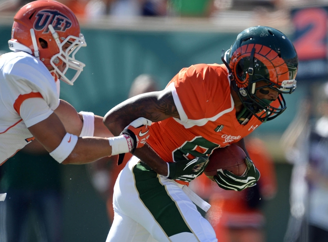 Sep 28, 2013; Fort Collins, CO, USA; Colorado State Rams wide receiver Rashard Higgins (82) pulls in a touchdown reception while being defended by UTEP Miners linebacker Cooper Foster (44) in the first quarter at Hughes Stadium. Mandatory Credit: Ron Chenoy-USA TODAY Sports