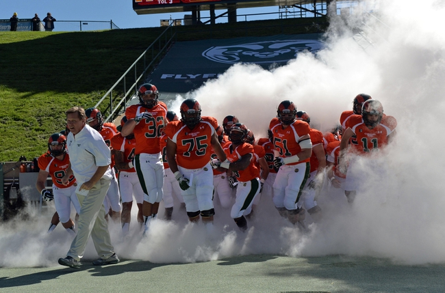 Sep 28, 2013; Fort Collins, CO, USA; Colorado State Rams head coach Jim McElwain leads out his team before the start of the game against the UTEP Miners at Hughes Stadium. Mandatory Credit: Ron Chenoy-USA TODAY Sports