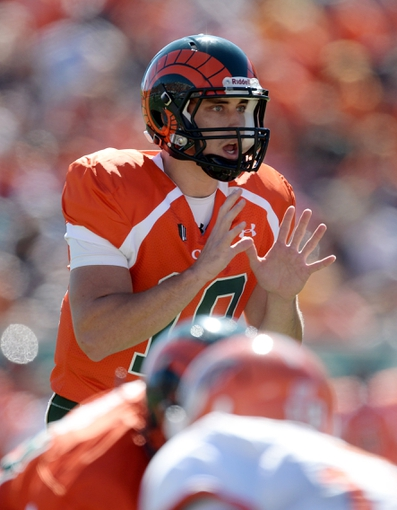 Sep 28, 2013; Fort Collins, CO, USA; Colorado State Rams quarterback Garrett Grayson (18)  at the line of scrimmage against the UTEP Miners in the first quarter at Hughes Stadium. Mandatory Credit: Ron Chenoy-USA TODAY Sports