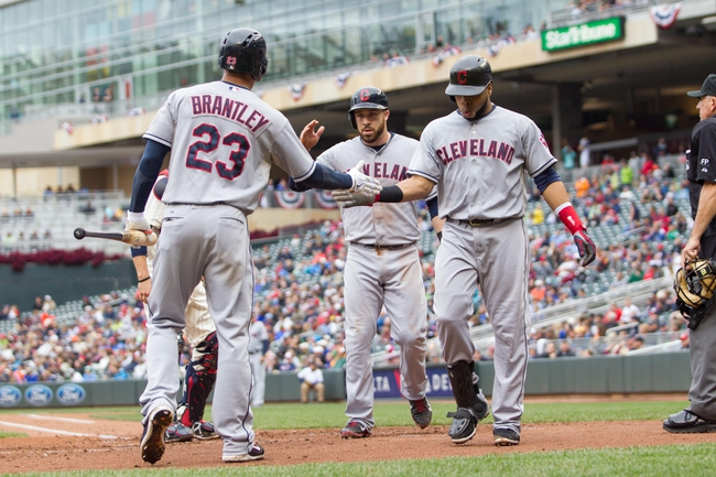 Sep 28, 2013; Minneapolis, MN, USA; Cleveland Indians catcher Carlos Santana (41) is congratulated by left fielder Michael Brantley (23) after his home run in the fourth inning against the Minnesota Twins at Target Field. Mandatory Credit: Brad Rempel-USA TODAY Sports