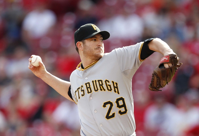 Sep 28, 2013; Cincinnati, OH, USA; Pittsburgh Pirates relief pitcher Bryan Morris (29) pitches during the ninth inning against the Cincinnati Reds at Great American Ball Park. The Pirates defeated the Reds 8-3. Mandatory Credit: Frank Victores-USA TODAY Sports