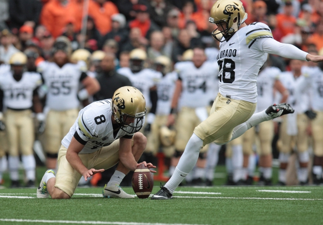 Sep 28, 2013; Corvallis, OR, USA; Colorado Buffaloes quarterback Jordan Webb (8) holds the ball for Colorado Buffaloes kicker Will Oliver (28) against the Oregon State Beavers at Reser Stadium. Mandatory Credit: Scott Olmos-USA TODAY Sports