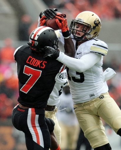 Sep 28, 2013; Corvallis, OR, USA; Colorado Buffaloes defensive back Parker Orms (13) defends against Oregon State Beavers wide receiver Brandin Cooks (7) at Reser Stadium. Mandatory Credit: Scott Olmos-USA TODAY Sports