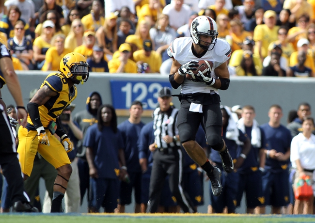 Sep 28, 2013; Morgantown, WV, USA; Oklahoma State Cowboys wide receiver Charlie Moore (17) makes a catch against West Virginia Mountaineers corner back Brandon Napoleon at Milan Puskar Stadium. Mandatory Credit: Peter Casey-USA TODAY Sports