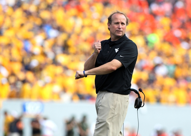 Sep 28, 2013; Morgantown, WV, USA; West Virginia Mountaineers head coach Dana Holgorsen during the game against the Oklahoma State Cowboys at Milan Puskar Stadium. Mandatory Credit: Peter Casey-USA TODAY Sports