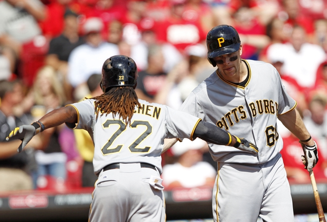 Sep 28, 2013; Cincinnati, OH, USA; Pittsburgh Pirates center fielder Andrew McCutchen (22) is congratulated by first baseman Justin Morneau (66) after hitting a home run during the third inning against the Cincinnati Reds at Great American Ball Park. Mandatory Credit: Frank Victores-USA TODAY Sports