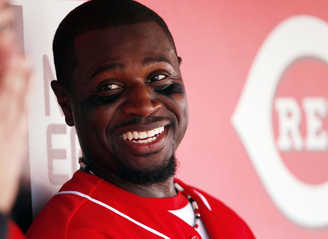 Sep 28, 2013; Cincinnati, OH, USA; Cincinnati Reds second baseman Brandon Phillips (4) in the dugout during the third inning against the Pittsburgh Pirates at Great American Ball Park. Mandatory Credit: Frank Victores-USA TODAY Sports