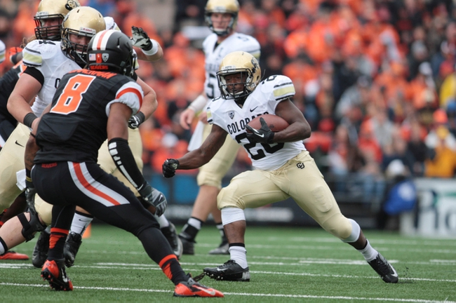 Sep 28, 2013; Corvallis, OR, USA; Colorado Buffaloes running back Tony Jones (26) runs the ball against the Oregon State Beavers at Reser Stadium. Mandatory Credit: Scott Olmos-USA TODAY Sports