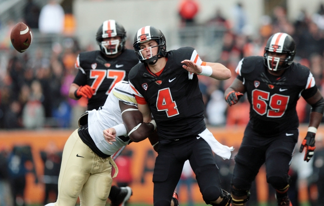 Sep 28, 2013; Corvallis, OR, USA; Oregon State Beavers quarterback Sean Mannion (4) fumbles the ball in the second quarter against the Colorado Buffaloes at Reser Stadium. Mandatory Credit: Scott Olmos-USA TODAY Sports