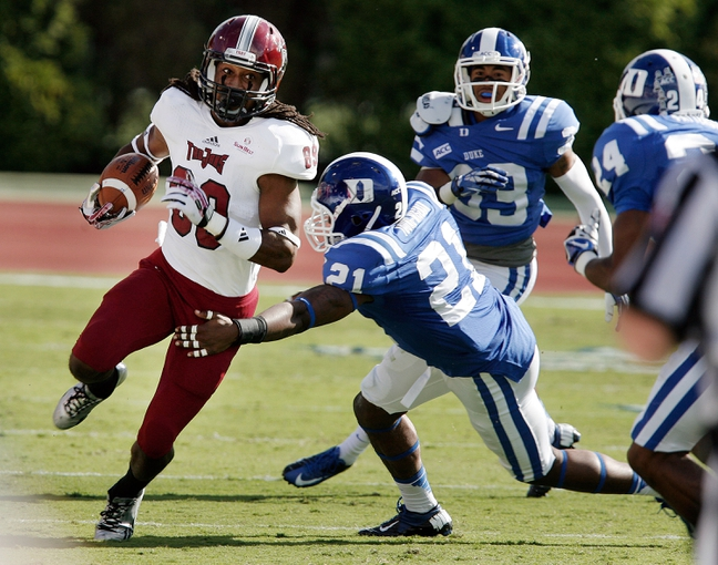 Sep 28, 2013; Durham, NC, USA;  Duke Blue Devils safety Anthony Young-Wiseman (21) tackles Troy Trojans wide receiver Chris Williams (89) at Wallace Wade Stadium. Mandatory Credit: Mark Dolejs-USA TODAY Sports