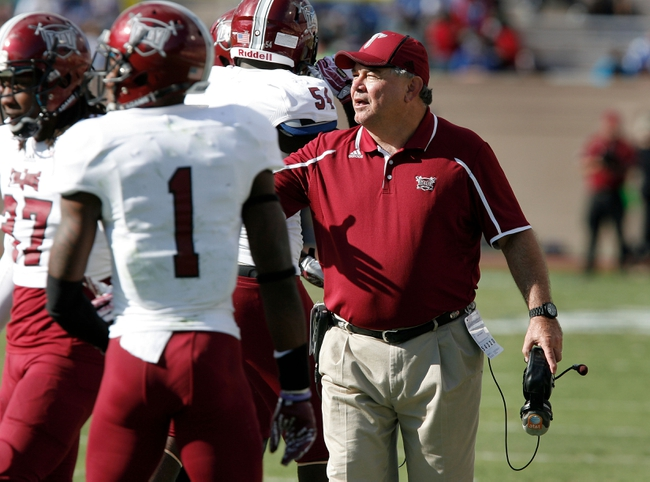 Sep 28, 2013; Durham, NC, USA;  Troy Trojans head coach Larry Blakeney talks to his players as they come off the field against the Duke Blue Devils at Wallace Wade Stadium. Mandatory Credit: Mark Dolejs-USA TODAY Sports