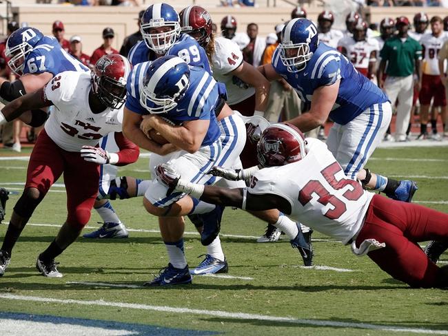 Sep 28, 2013; Durham, NC, USA;  Duke Blue Devils quarterback Brandon Connette (18) runs for a touchdown against the Troy Trojans at Wallace Wade Stadium. Mandatory Credit: Mark Dolejs-USA TODAY Sports