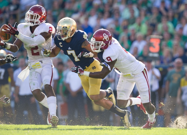 Sep 28, 2013; South Bend, IN, USA; Oklahoma Sooners defensive back Julian Wilson (2) intercepts a pass intended for Notre Dame Fighting Irish wide receiver TJ Jones (7) in the second quarter at Notre Dame Stadium. Mandatory Credit: Matt Cashore-USA TODAY Sports