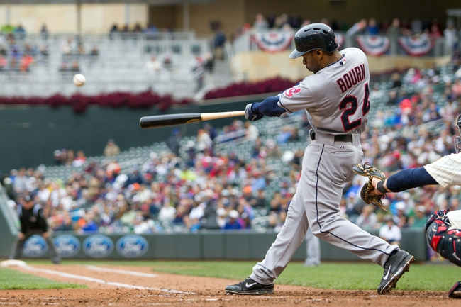 Sep 28, 2013; Minneapolis, MN, USA; Cleveland Indians center fielder Michael Bourn (24) hits a double in the fifth inning against the Minnesota Twins at Target Field. Mandatory Credit: Brad Rempel-USA TODAY Sports