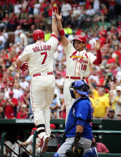 Sep 28, 2013; St. Louis, MO, USA; St. Louis Cardinals left fielder Matt Holliday (7) celebrates with center fielder Jon Jay (19) after hitting a two run home run off of Chicago Cubs starting pitcher Edwin Jackson (not pictured) during the first inning at Busch Stadium. Mandatory Credit: Jeff Curry-USA TODAY Sports